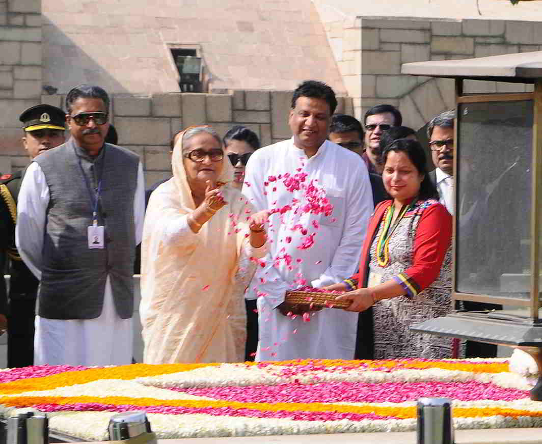RESPECT: Prime Minister of Bangladesh Sheikh Hasina pays floral tributes at the Samadhi of Mahatma Gandhi, at Rajghat, in Delhi, UNI