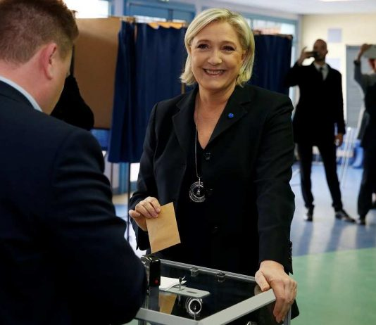 Le Pen casts her vote during the first round of presidential elections