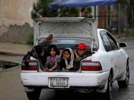 A SEPARATE PEACE: Children ride in the trunk of a car in Kabul, Afghanistan, Reuters/UNI