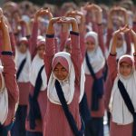 HEALTH IS WEALTH: Muslim girls practice yoga during a training session at a school compound ahead of International Yoga Day in Ahmedabad, Reuters/UNI
