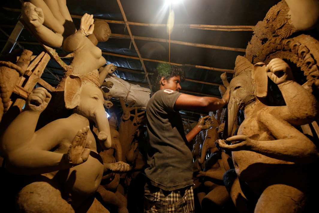 FOR PROSPERITY: An artiste makes an idol of the elephant god at a workshop in Bengaluru, India, Reuters/UNI