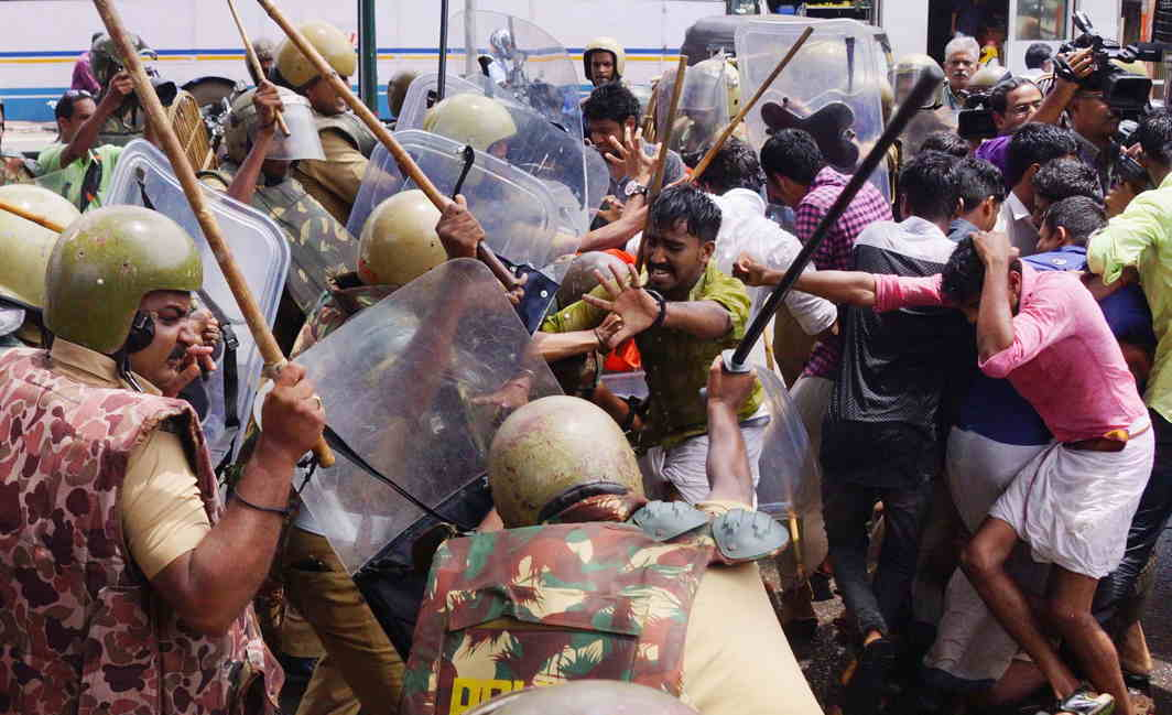 RAINING BLOWS: Police lathicharge ABVP activists during a march for withdrawal of hike in the fees for medical courses in self-financing medical colleges in Thiruvananthapuram, UNI