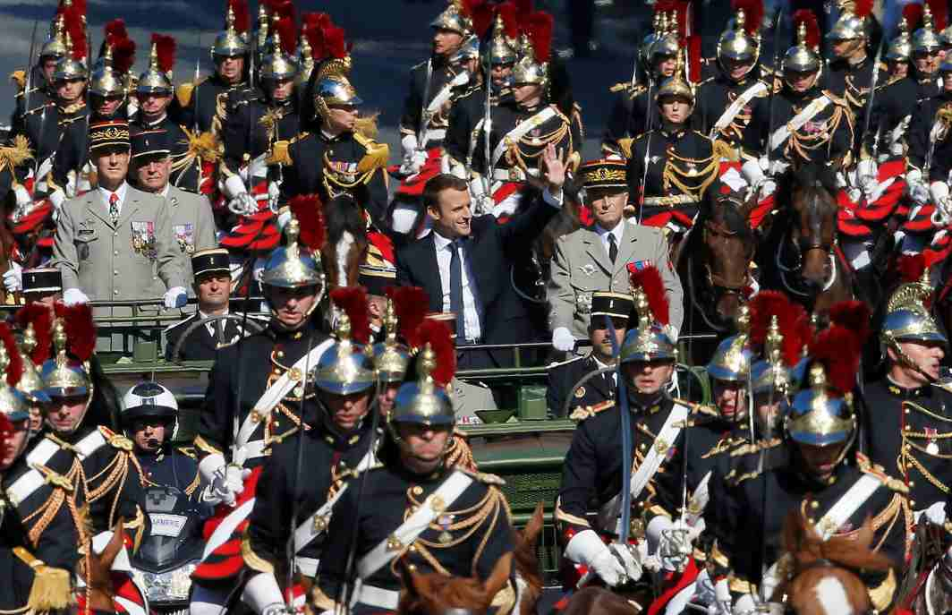 LIBERTY, EQUALITY, FRATERNITY: French President Emmanuel Macron and Chief of the Defence Staff French Army General Pierre de Villiers arrive in a command car for the traditional Bastille Day military parade on the Champs-Elysees in Paris, France, Reuters/UNI