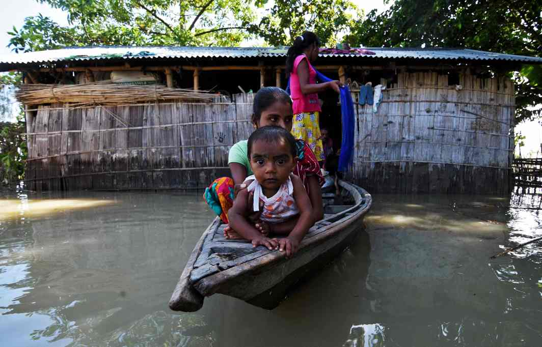 AFTER THE DELUGE: Villagers use a boat as they try to move to safer places at a flood-affected village in Darrang district in the northeastern state of Assam, Reuters/UNI