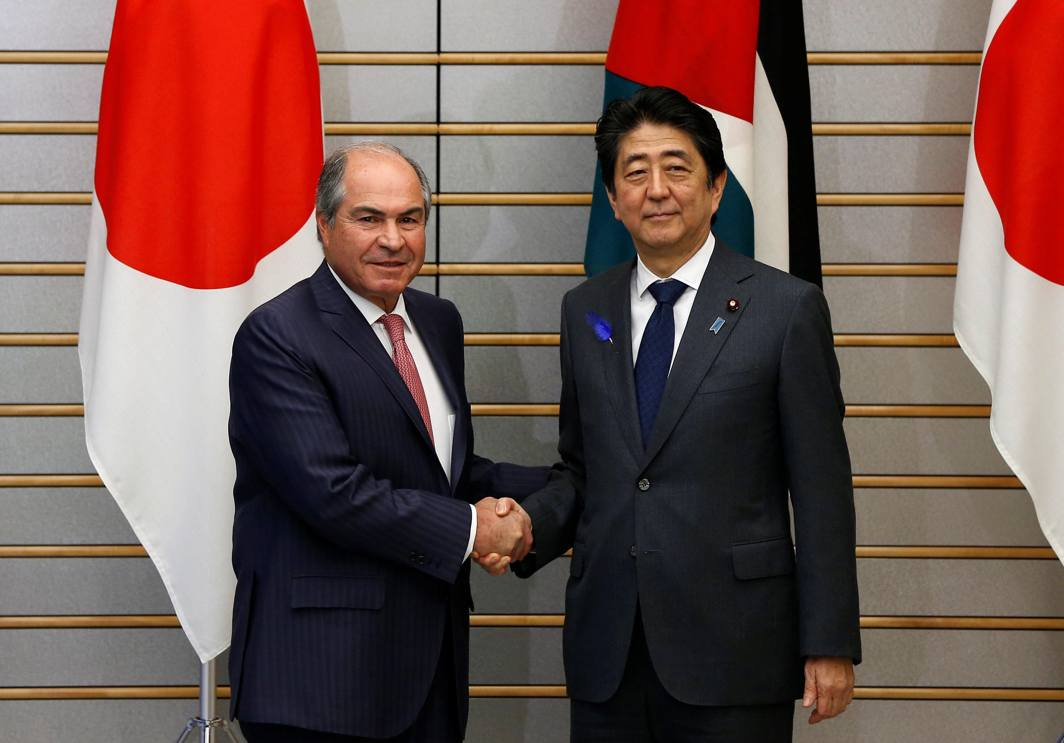 WHAT'S ON AGENDA? Jordanian Prime Minister and Defence Minister Hani al-Mulki (L) shakes hands with Japanese Prime Minister Shinzo Abe at the start of their talks at Abe's official residence in Tokyo, Japan, Reuters/UNI