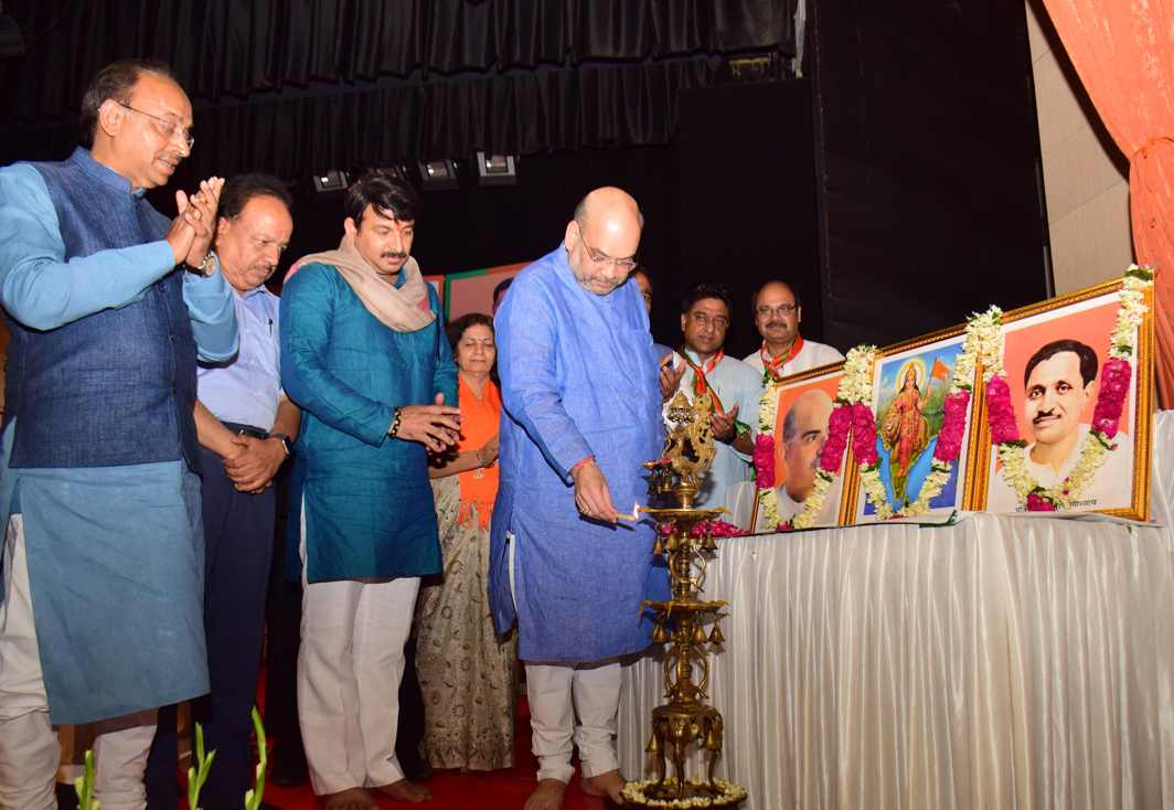 CEREMONY IS MUST: BJP president Amit Shah lights the ceremonial lamp to inaugurate the group meeting of Delhi BJP workers, in New Delhi, UNI