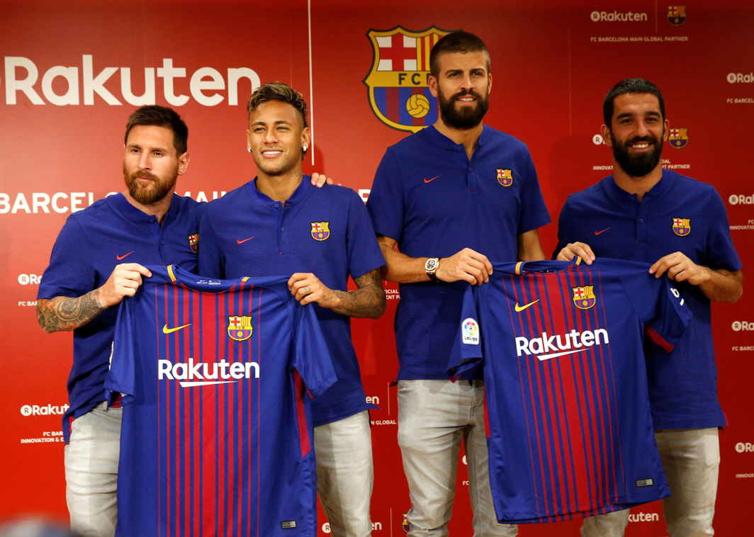 STARS LINE UP: FC Barcelona players (L-R) Lionel Messi , Neymar, Gerard Pique and Arda Turan holding their uniforms pose for a photo during a news conference to announce the sponsorship deal between the team and Japanese e-commerce operator Rakuten Inc. in Tokyo, Reuters/UNI