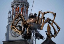 BITE ME: The giant mechanical spider Kumo, created by French production company La Machine, is lowered in front of the Notre-Dame Cathedral Basilica during a performance in Ottawa, Canada, Reuters/UNI