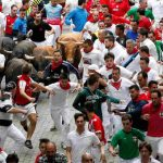 FIND YER MOJO: Runners sprint ahead of bulls during the seventh running of the bulls at the San Fermin festival in Pamplona, northern Spain, Reuters/UNI
