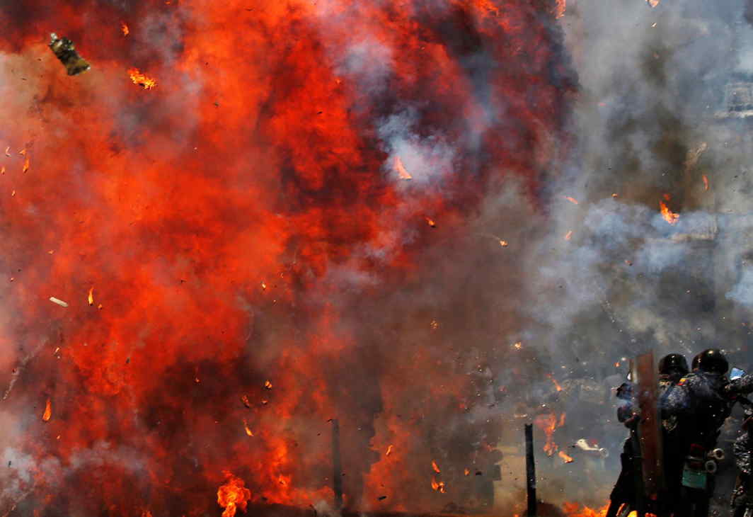 ANARCHY: Flames erupt as clashes break out while the Constituent Assembly election is being carried out in Caracas, Venezuela, Reuters/UNI