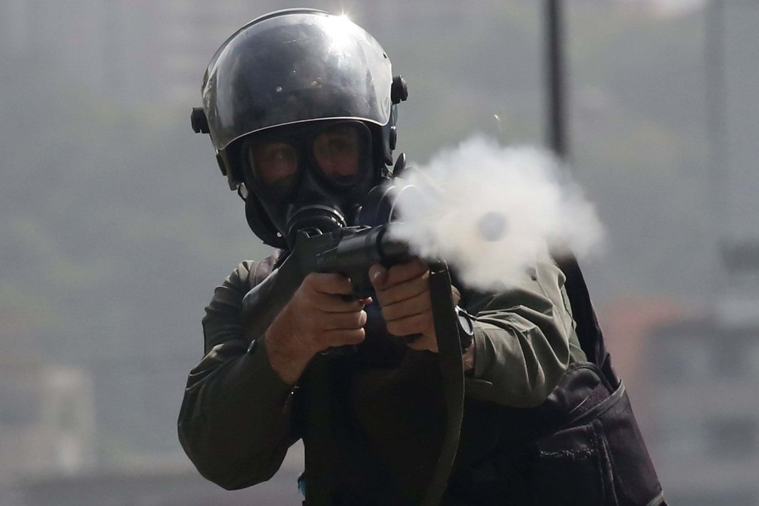 LONG ROAD TO FREEDOM: A member of the security forces fires tear gas during clashes at a protest against Venezuelan President Nicolas Maduro's government in Caracas, Venezuela, Reuters/UNI