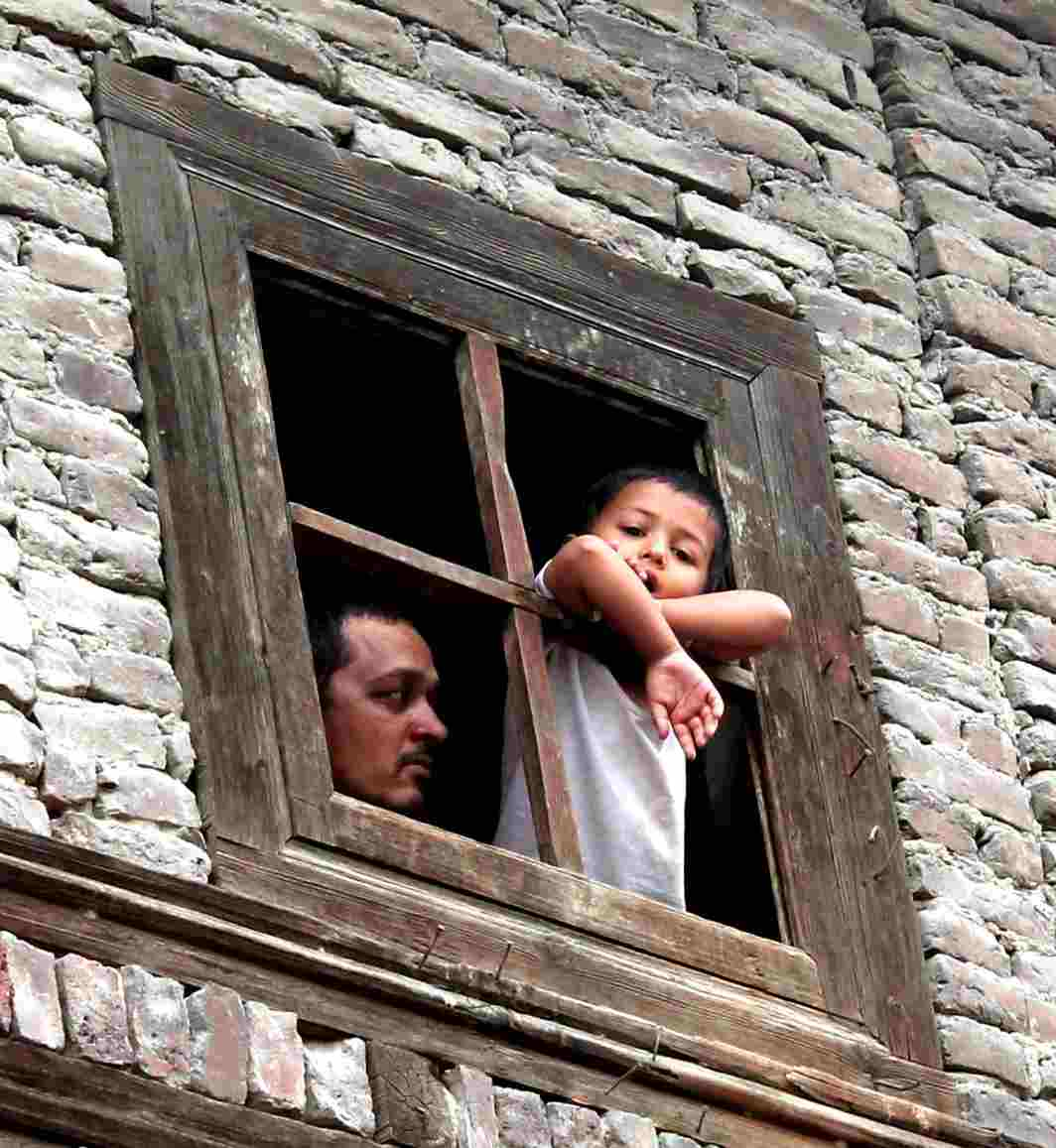 NO GOING OUT: A child peeping through a window Nawab Bazar where curfew was imposed along with Shar-e-Khas in down town Srinagar as a precautionary measure to prevent any violence as one of the three Hizbul Mujahideen militants killed in an encounter in the central Kashmir district of Badgam was a resident of Nowhatta, UNI