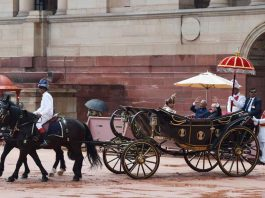 HELLO, GOODBYE: Incumbent president Ram Nath Kovind and outgoing president Pranab Mukherjee take a buggy ride after the guard of honour ceremony at Rashtrapati Bhavan, in New Delhi, PIB