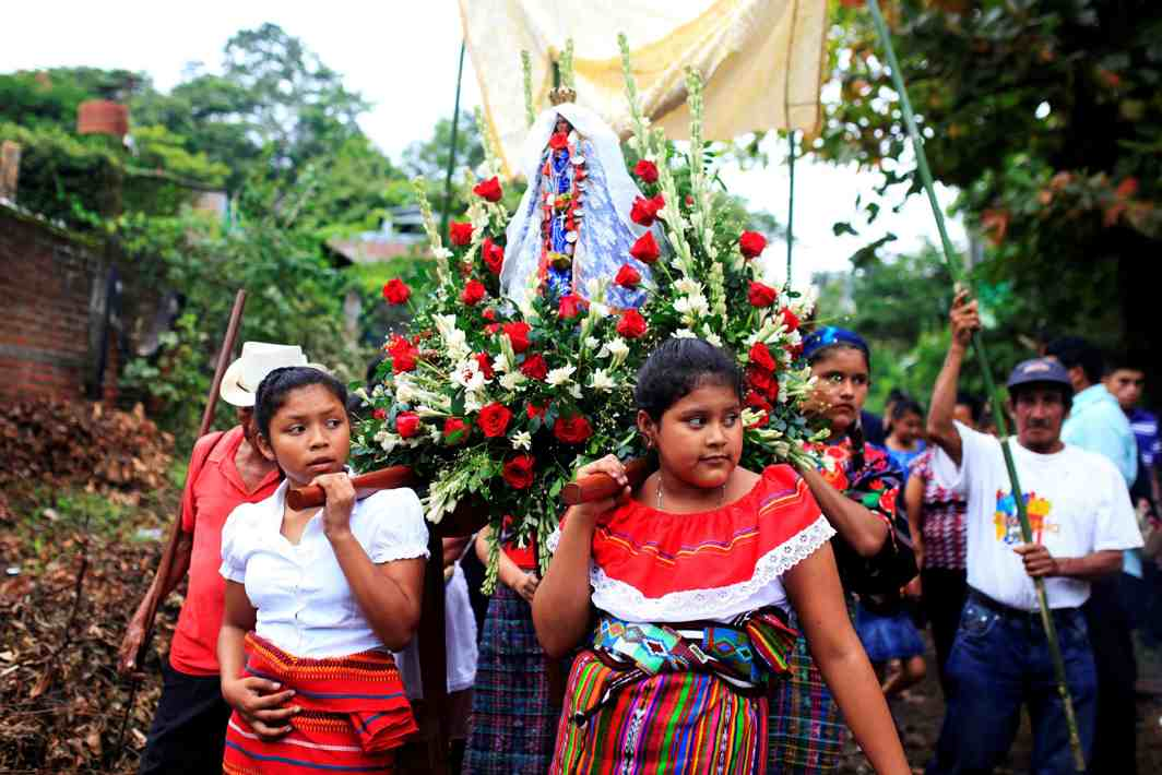 WALK OF FAITH: Women participate in an indigenous procession in honour of the Virgin of Los Angeles known as