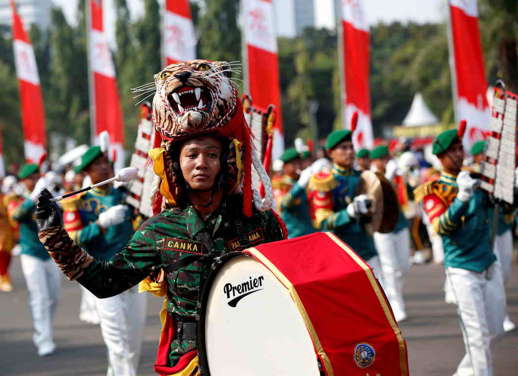 PROUD COLOURS: A military band marches towards the Presidential Palace from the National Monument during Independence Day celebrations in Jakarta, Indonesia, reuters/UNI