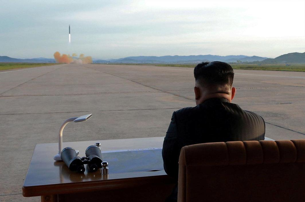 DANGEROUS GAMES: North Korean leader Kim Jong Un watches the launch of a Hwasong-12 missile in this undated photo released by North Korea's Korean Central News Agency (KCNA), Reuters/UNI
