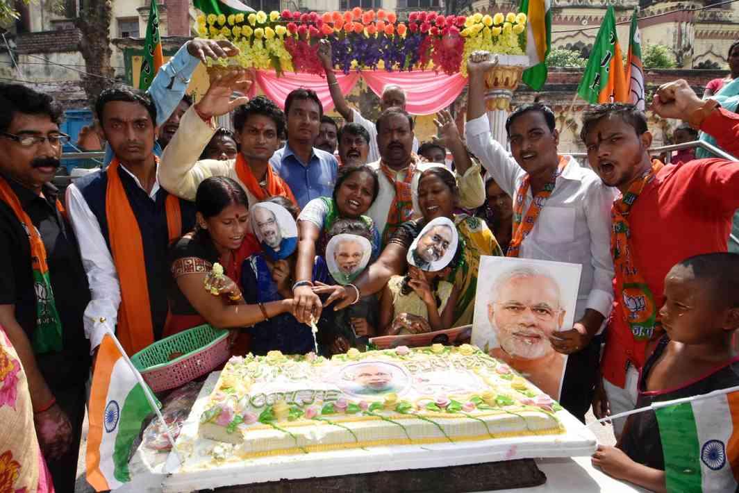 EAT IT TOO: BJP supporters celebrate the birthday of Prime Minister Narendra Modi in Patna, UNI