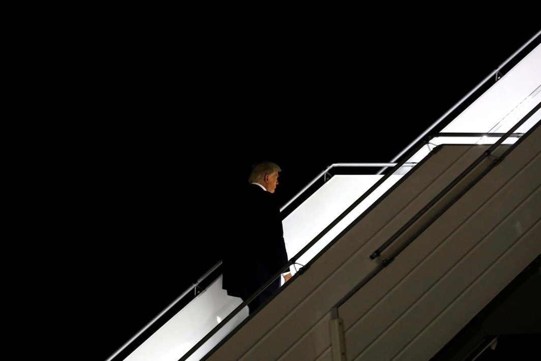 GOES THE PRESIDENT: US President Donald Trump boards Air Force One for travel to Washington, from JFK International airport in New York, Reuters/UNI