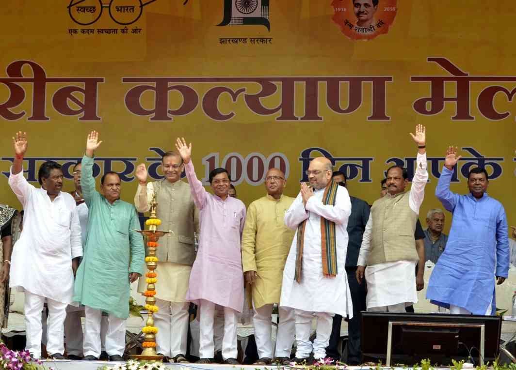 "HANDOUTS TIME: BJP national president Amit Shah at the inauguration of the ""Poor Welfare Fair"" organised on completion of 1,000 days of the Jharkhand government, in Ranchi, UNI"