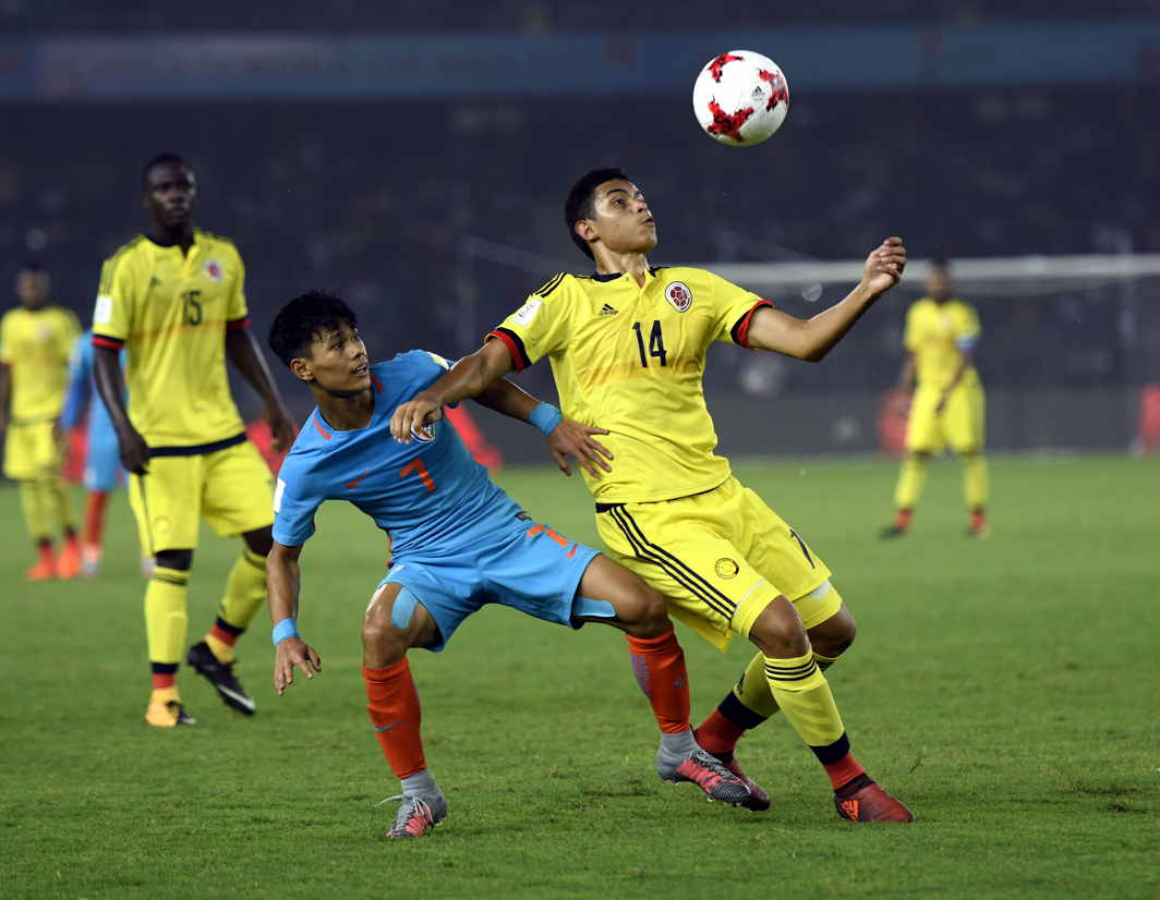 FULL OF HEART: India's U-17 World Cup soccer team in action. They went down fighting 1-2 against Colombia in their second encounter of Group A in the ongoing FIFA Under-17 World Cup in New Delhi, UNI