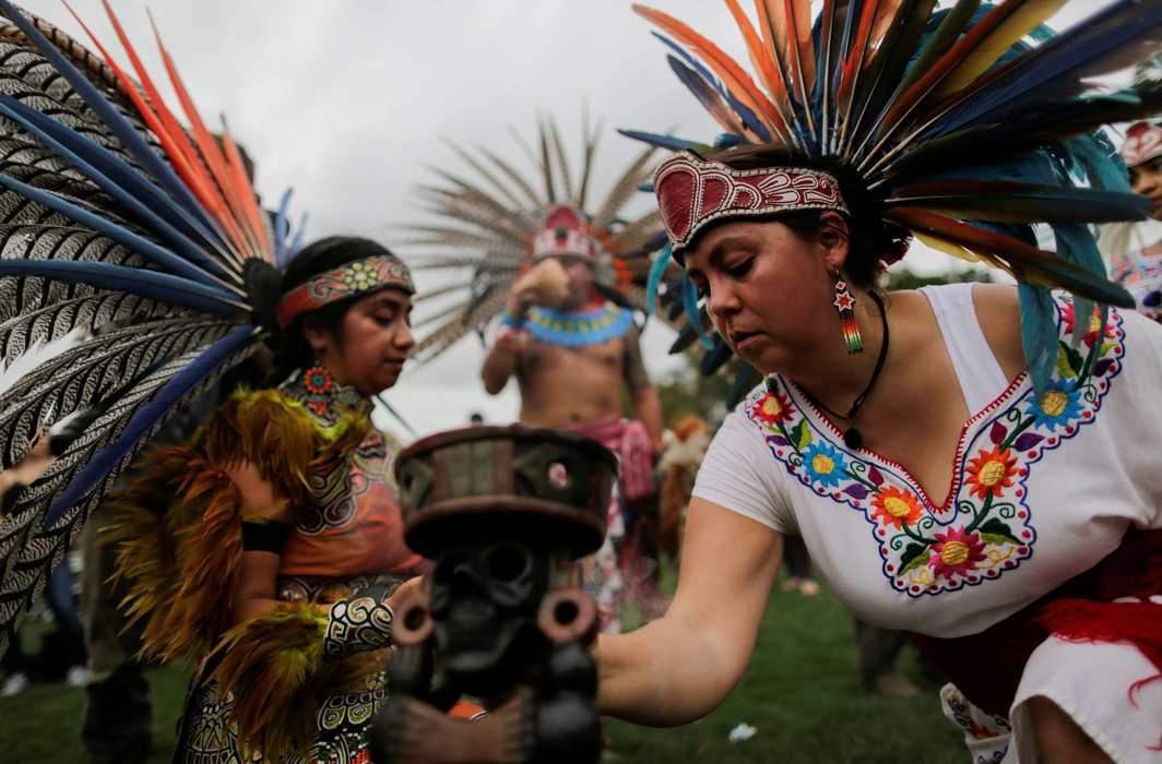"WHO WE ARE: Revellers perform during a ""pow-wow"" celebrating the Indigenous Peoples' Day Festival in Randalls Island, New York, US. The festival is held as a counter-celebration to Columbus Day and to promote Native American culture and history, Reuters/UNI"