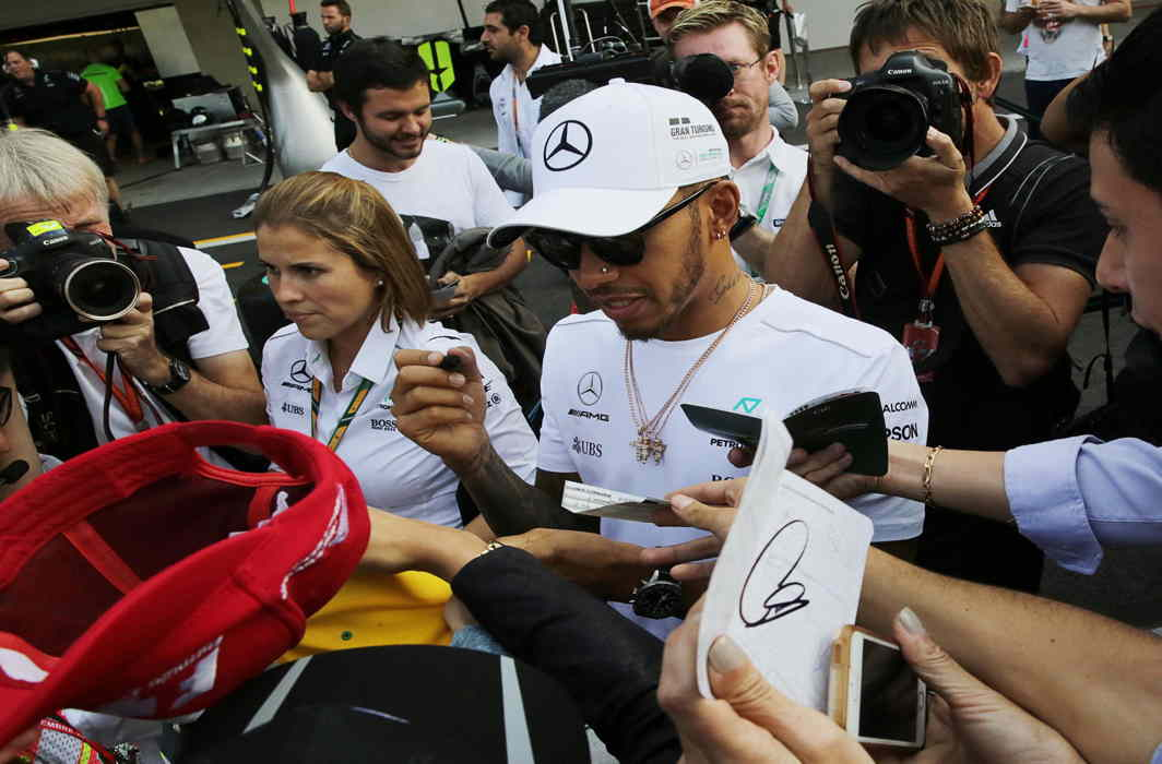 VROOM GOD: Mercedes' Lewis Hamilton of Britain autographs a cap for a fan ahead of the Mexican Grand Prix at Autodromo Hermanos Rodriguez in Mexico City, Mexico, Reuters/UNI