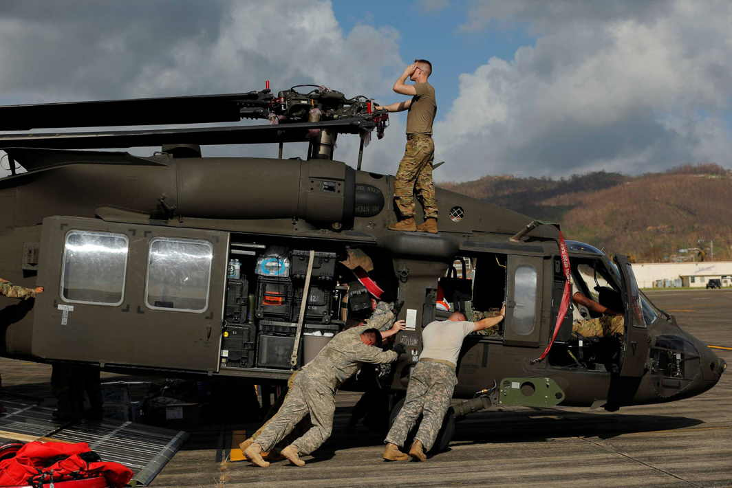 HELPING HAND: Soldiers with the US Army's 1st Armored Division, Combat Aviation Brigade, work to unload a UH-60 Blackhawk helicopter from a US Air Force C-5 Galaxy to aid in recovery efforts following Hurricane Maria in Roosevelt Roads, Puerto Rico, Reuters/UNI