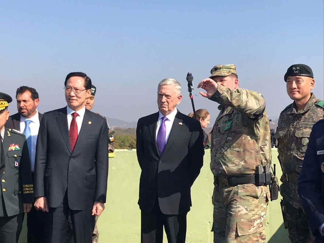 BORDER VIEW: US defence secretary Jim Mattis and his South Korean counterpart Song Young-moo peer into North Korea from Observation Post Ouellette in the demilitarized zone separating North and South Korea, Reuters/UNI