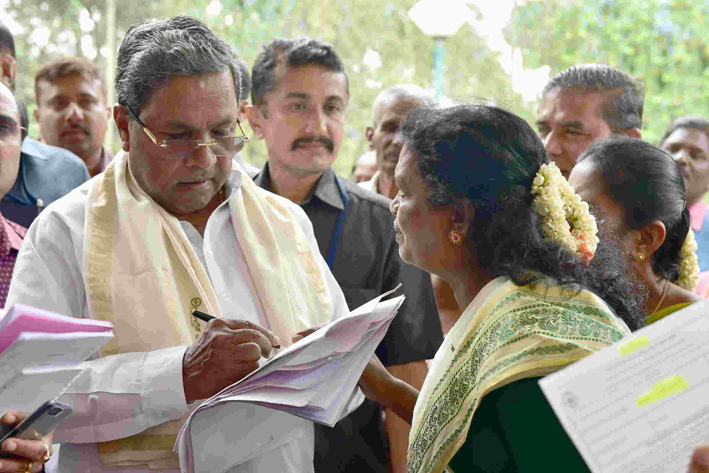 EAR TO THE GROUND: Karnataka Chief Minister Siddaramaiah hears public grievances at Cauvery in Bengaluru, UNI