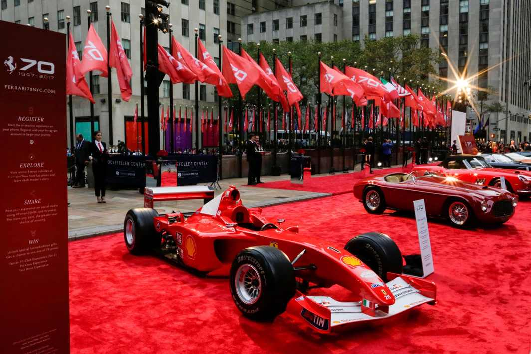 HIS LEGACY: Former Ferrari German F1 driver Michael Schumacher's Monaco Grand Prix winning Ferrari F2001 car, on display with other models at the Rockefeller Plaza in celebrations of Ferrari's 70th anniversary, in New York, US, Reuters/UNI