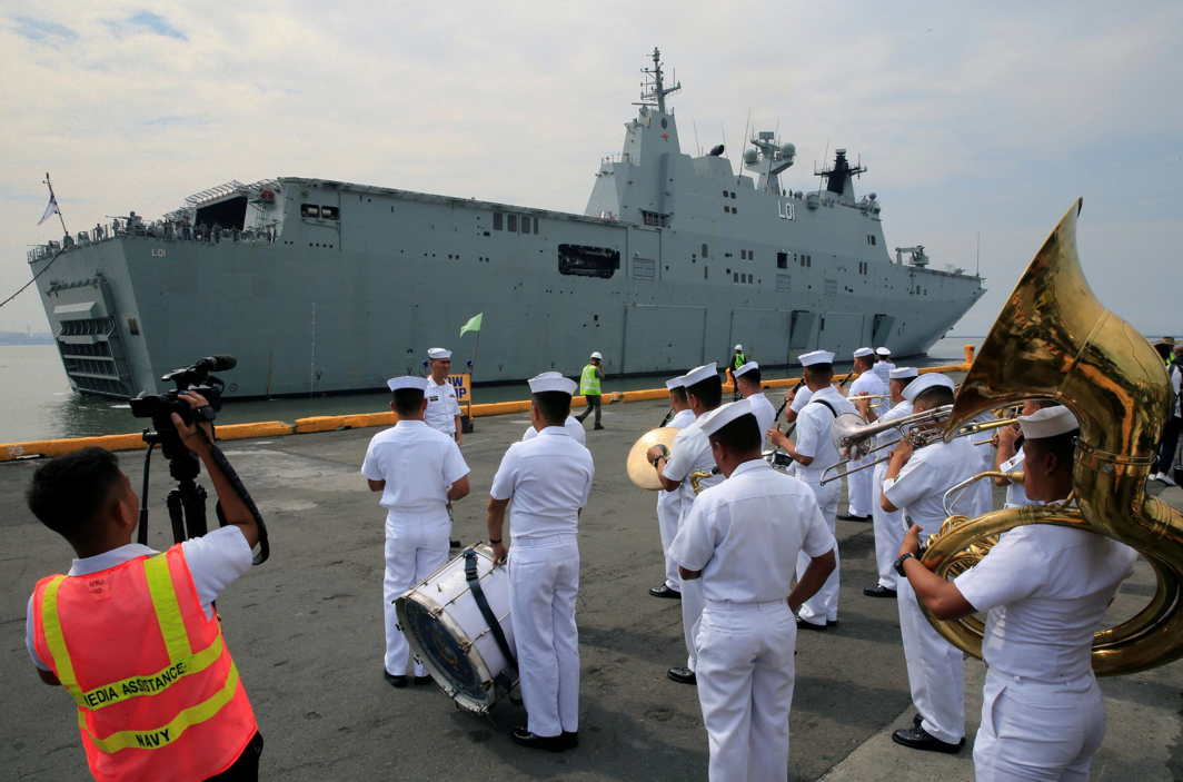 PACIFIC BEAT: The Philippine Navy band welcomes the Royal Australian Navy vessel, Her Majesty's Australian Ship (HMAS) Adelaide (III), upon arrival for a goodwill visit as part of the Australian Defence Force (ADF) Joint Task Group, Indo-Pacific Endeavour 2017, at the Pier 15, south harbour in Metro Manila, Philippines, Reuters/UNI