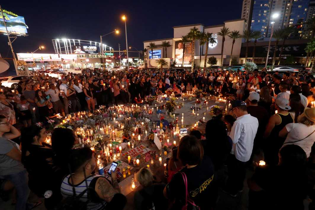 MOURNING WHAT'S LOST: Hundreds of people attend a vigil marking one week of the October 1 mass shooting in Las Vegas, Nevada, Reuters/UNI