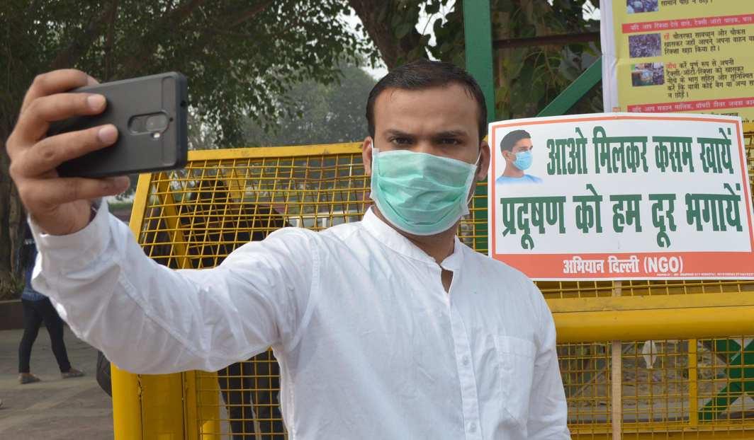 MARKED SAFE: A man takes a selfie during a highly smoggy afternoon in New Delhi, UNI
