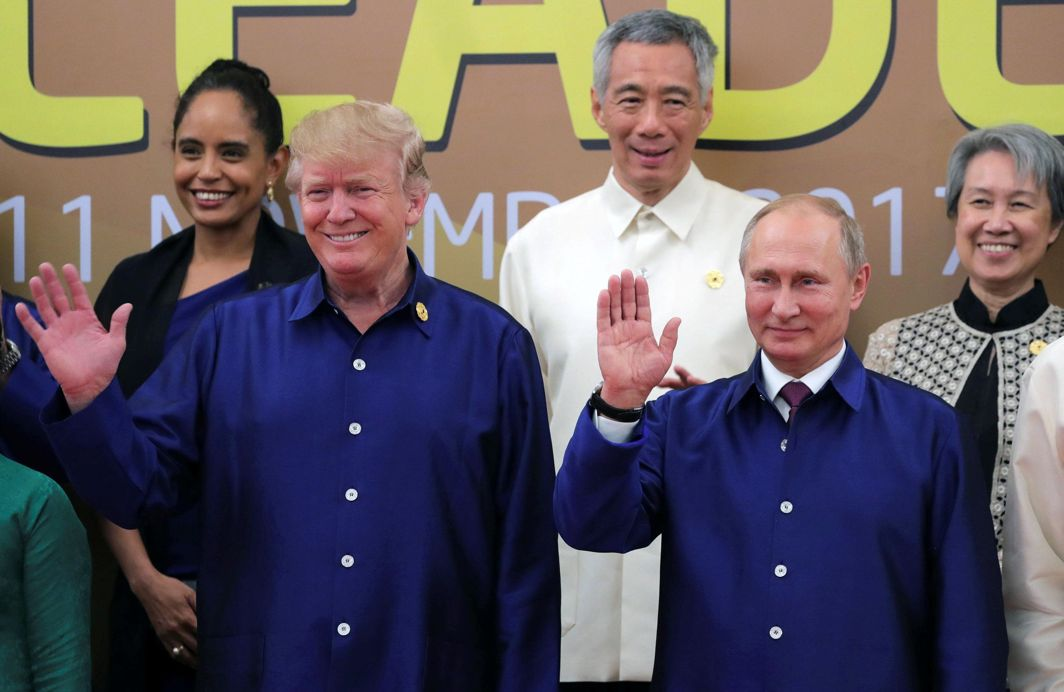 I SWEAR: US President Donald Trump and Russian President Vladimir Putin take part in a family photo at the APEC summit in Danang, Vietnam, Reuters/UNI