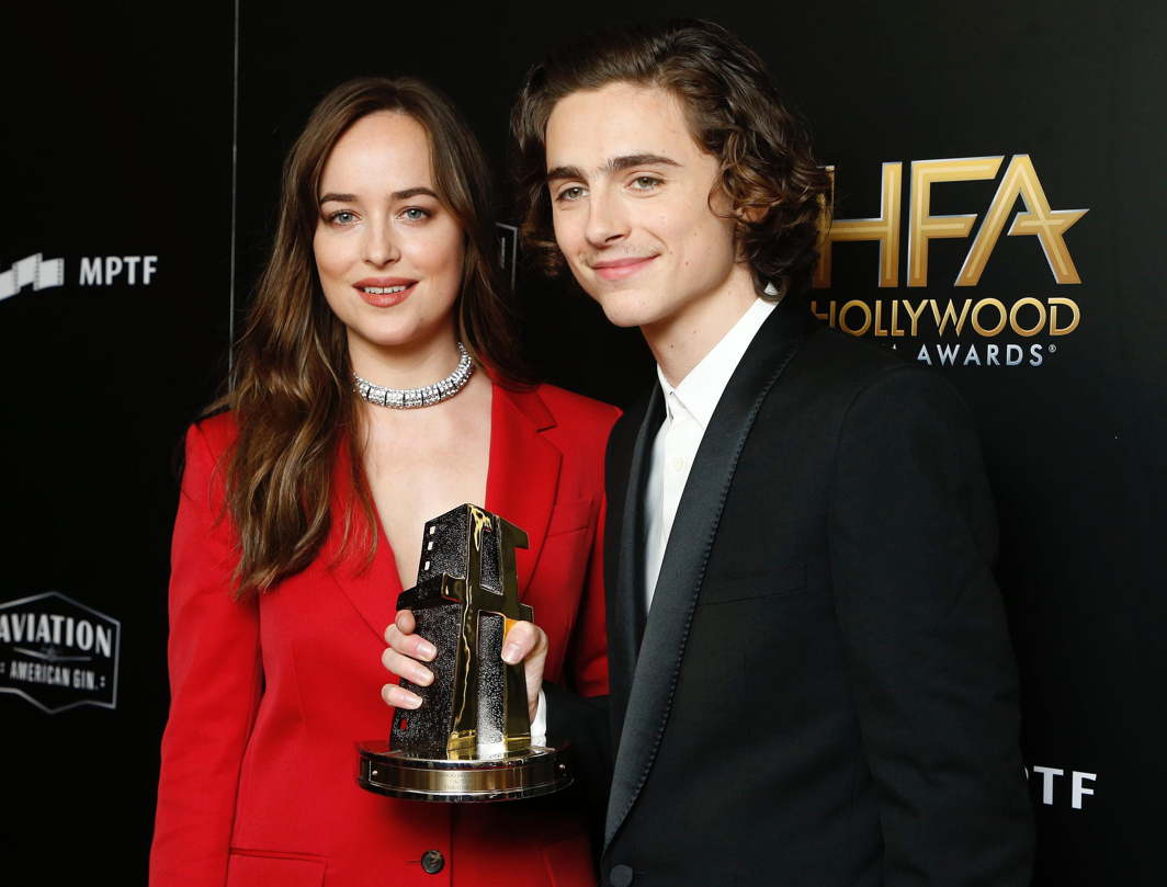 "PRETTY PAIR: Dakota Johnson and Timothee Chalamet with his Hollywood Breakout Performance Actor Award for ""Call Me By Your Name"" during the 21st Annual Hollywood Film Awards Photo Room, Beverly Hills, California, US, Reuters/UNI"