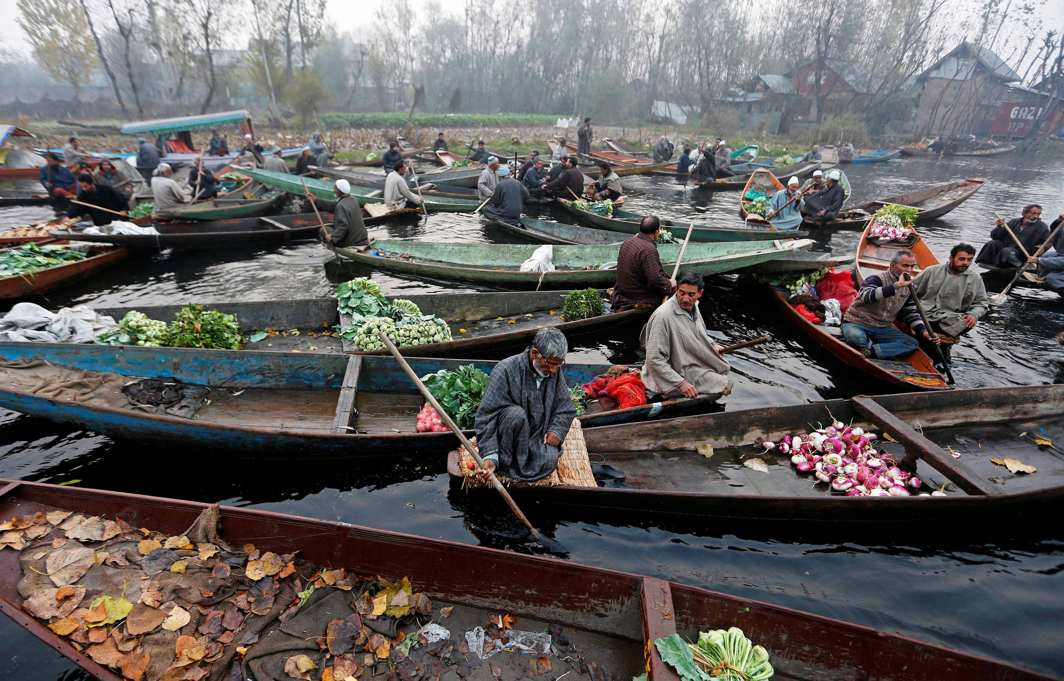 FLOATING MARKET: Vegetable vendors at a floating market on the Dal Lake in Srinagar, Reuters/UNI