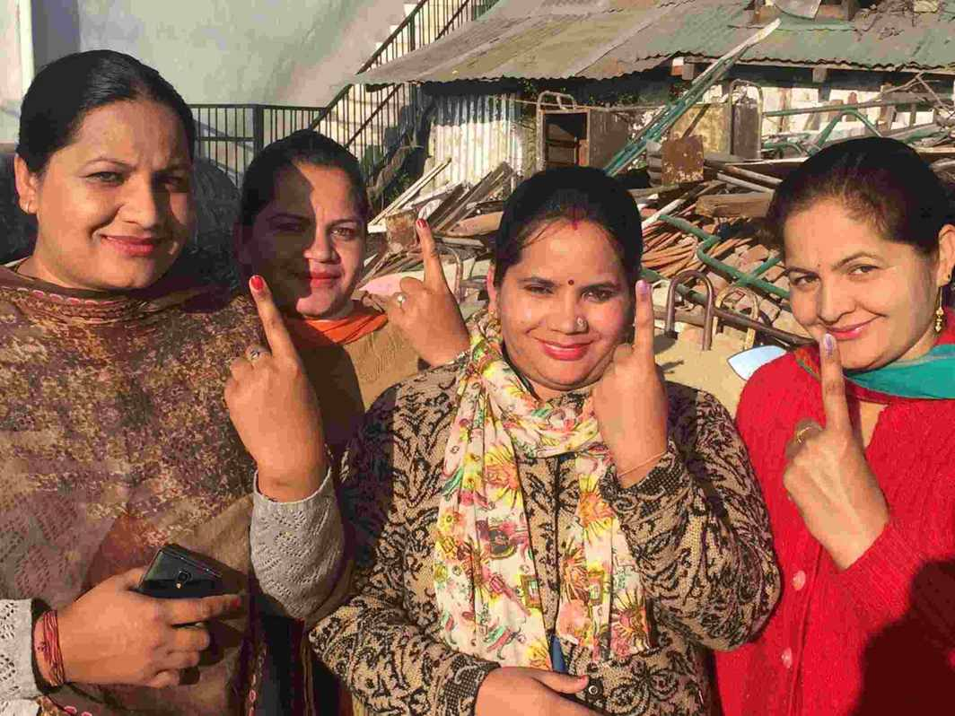 RESPONSIBLE CITIZENS: Voters show off their inked fingers after casting the vote outside a polling station in Hamirpur district, UNI