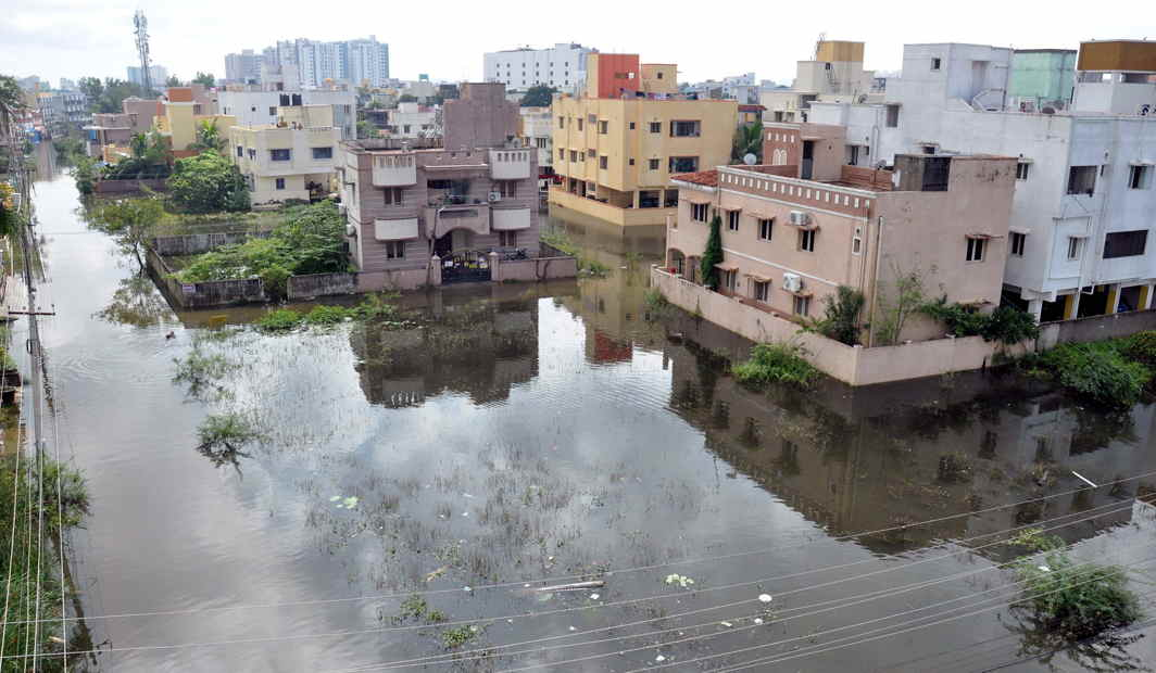 WET SPELL: A view of a waterlogged residential area at Velacherry following heavy rains, in Chennai, UNI