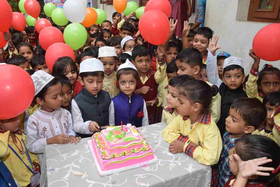 THEIR DAY: Schoolchildren cut cake during Children's Day celebrations on the occasion of the 128th birth anniversary of Chacha Jawaharlal Nehru, the first prime minister of India, in Patna, UNI