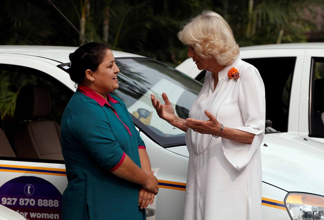 GOOD AT HER JOB: Camilla, Duchess of Cornwall, talks to a taxi driver during the 'Women on Wheels' event in New Delhi, Reuters/UNI