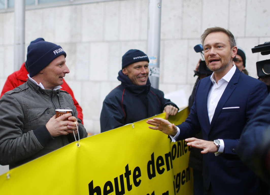 TALKING SUPPORT: Chairman of the Free Democratic Party (FDP) Christian Lindner talks with people gathered outside the CDU headquarters, as he arrives for exploratory talks about forming a new coalition government in Berlin, Germany, Reuters/UNI