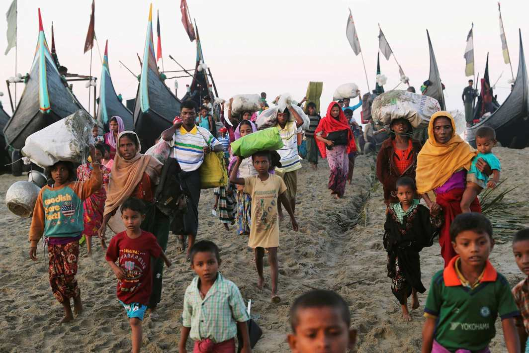 SAFE FOR NOW: A group of Rohingya refugees, who fled from Myanmar by boat last night, walks towards a makeshift camp in Cox's Bazar, Bangladesh, Reuters/UNI