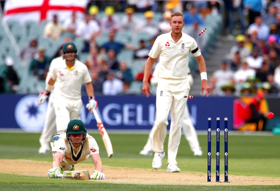 FALLING SHORT: England's Stuart Broad watches with Australia's David Warner as Cameron Bancroft is run out during the first day of the second Ashes cricket Test match in Adelaide, Australia, Reuters/UNI