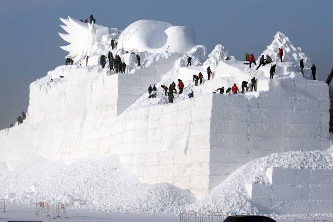 WORK OF PASSION: People prepare a snow sculpture for the Harbin Sun Island International Snow Sculpture Art Expo in Harbin, Heilongjiang province, China, Reuters/UNI