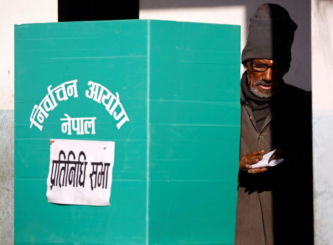MY VOTE: A man votes during the parliamentary and provincial elections in Thimi, Nepal, Reuters/UNI