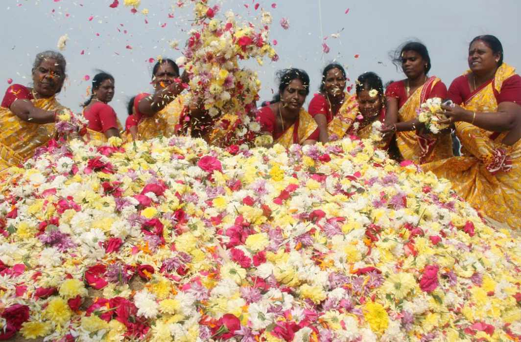 ETCHED IN MEMORY: Women offer floral tribute to tsunami victims on the 13th year of the disaster, in Chennai, UNI