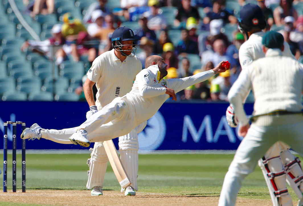GOOD REFLEXES: Australia's Nathan Lyon dives to take a catch to dismiss England's Moeen Ali during the third day of the second Ashes Test in Adelaide, Reuters/UNI