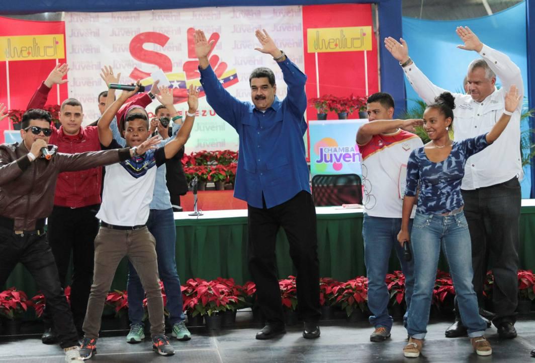 DANCE WITH ME: Venezuela's President Nicolas Maduro (C) dances during an event with supporters in Caracas, Venezuela, Reuters/UNI