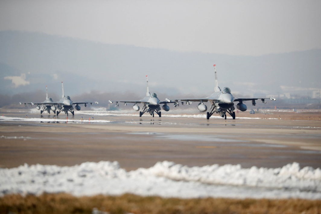 TAKE-OFF: US Air Force F-16 fighter jets take part in a joint aerial drill exercise called 'Vigilant Ace' between US and South Korea, at the Osan Air Base in Pyeongtaek, South Korea, Reuters/UNI