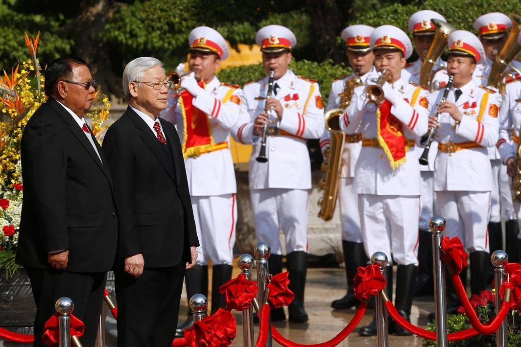 SALUTE: Laos' President Bounnhang Vorachith (left) and Vietnam's Communist Party General Secretary Nguyen Phu Trong attend a welcoming ceremony at the presidential palace in Hanoi, Vietnam, Reuters/UNI
